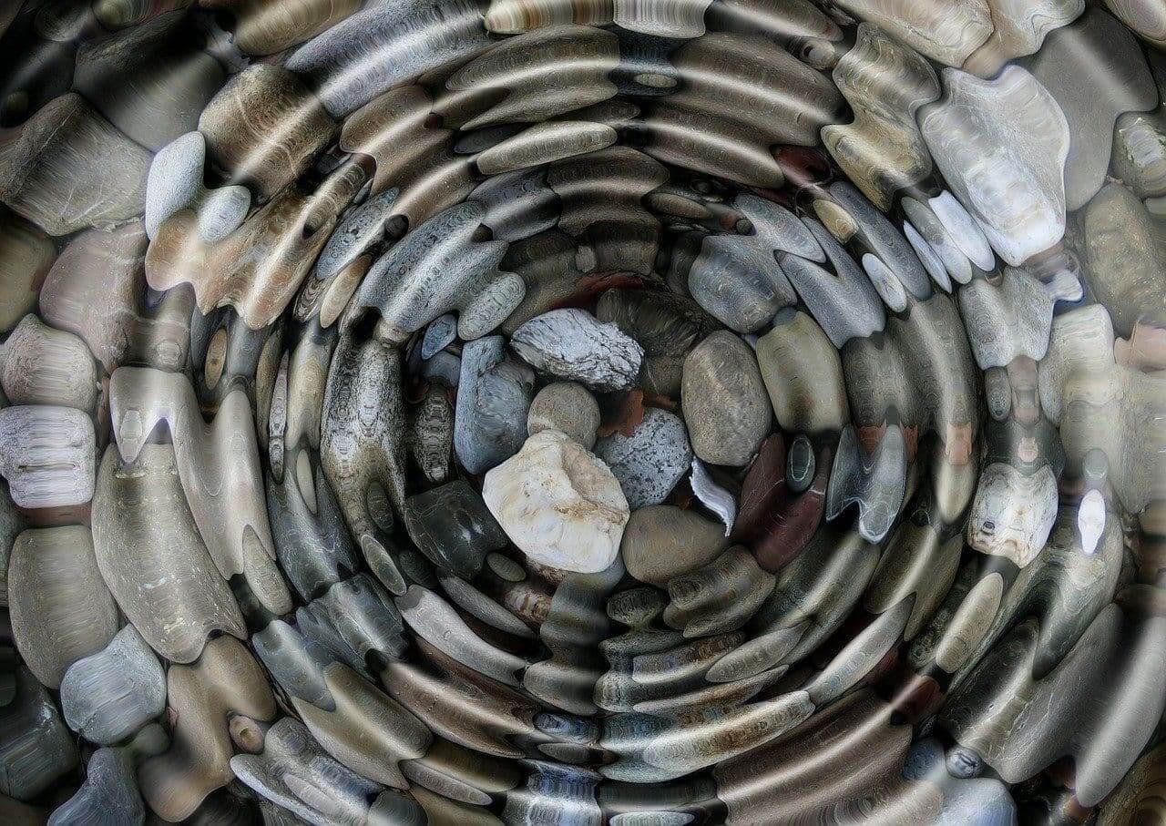 Water ripple over stones